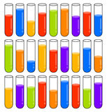 Multicolored test tubes with liquids at different levels Royalty Free Stock Photos