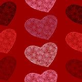 Vector naadloos patroon van harten op een bloed-rode achtergrond Stock Fotografie