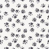 Vector nahtloses Muster mit Tatzenabdrücken eines Hundes Stockbilder