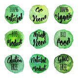 Vector natural organic badges and labels. Ecology logotypes on abstract watercolor paint blots, stains and splashes isolated on a white background. Eco, organic Stock Illustration
