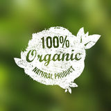 Vector natural organic food grunge vintage label. Natural product symbol on blurred nature background. Royalty Free Stock Images
