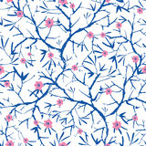 Vector navy blue, pink, and white blooming sakura bracnhes painted texture. Seamless repeat pattern background. Great. For wallpaper, cards, fabric, wrapping Stock Image