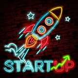 Vector  neon sign of rocket and clouds for decoration on the wall background. Realistic neon logo for startup. Concept of business and success Stock Image