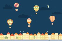 Vector night landscape with air balloons and town. Vector illustration of landscape with hot air balloons in night sky in town. Isolated flat cartoon air Stock Photo