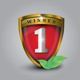 Vector no 1 winner golden label - shield. And leaves Royalty Free Stock Photo