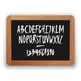 Vector Numbers and Uppercase Letters on a Blackboard. Vector numbers and uppercase letters. Hand written latin alphabet on a blackboard. Isolated on white vector illustration