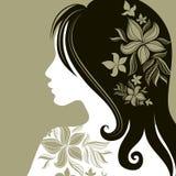 Vector o retrato da mulher com a flor no cabelo ilustração royalty free