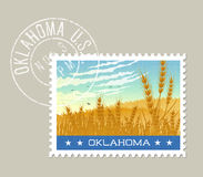 Vector of Oklahoma wheat fields under morning sky. Oklahoma postage stamp design. Vector illustration of wheat fields under morning sky. Grunge postmark on Stock Image