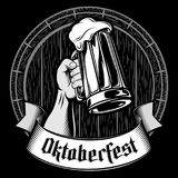 Vector Oktoberfest Beer Glass Mug Barrel Foam Enrgaving Black Gray. Glass of Beer in hand. Foamy lager in mug on a barrel background. The banner ribbon with royalty free illustration