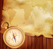Vector old map with a compass. On a wooden background Royalty Free Stock Photo