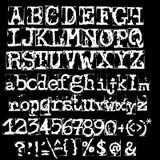 Vector old typewriter font. Vintage grunge letters. Old destroyed printed letters. Stock Photos