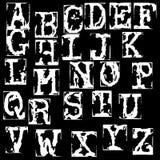 Vector old typewriter font. Vintage grunge letters. Old destroyed printed letters. Stock Images