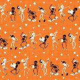 Vector orange, black dancing and skateboarding skeletons Haloween mesh fabric repeat pattern background. Great for Royalty Free Stock Images