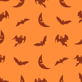 Vector orange Halloween background. With ghosts, bats and moon. Seamless holiday pattern Stock Image