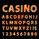 Vector orange neon lamp letters font show casino or theather Stock Photo