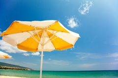 Vector orange umbrella on beautiful beach Stock Photo