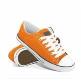 Vector oranje tennisschoenen Stock Afbeelding