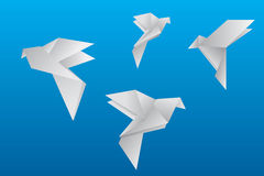 Vector origami doves flying in air. Stock Images