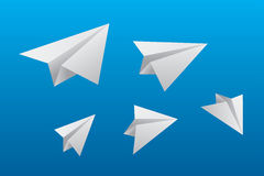 Vector origami paper planes on blue sky background. Royalty Free Stock Image
