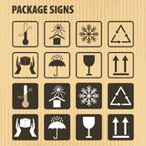 Vector packaging symbols on  cardboard background. Icon set including fragile, this side up, handle with care, keep dry and Stock Photos