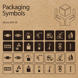 Vector packaging symbols on vector cardboard background. Icon set including Don't roll, Protect from radiation, Clamp here, Handle with care and other caution Stock Photo