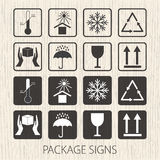 Vector packaging symbols on  wooden background. Icon set including fragile, this side up, handle with care, keep dry and oth Royalty Free Stock Images