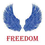 Vector pair of bird wings with freedom inscription Stock Images