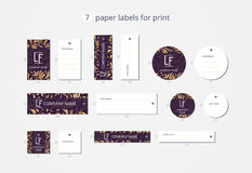 Vector paper clothing labels for print with pattern gold lilies Royalty Free Stock Image