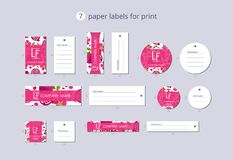 Vector paper clothing labels for print with pattern pomegranate and flower. On blue field Royalty Free Stock Photography