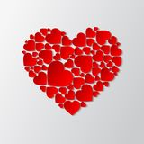 Vector paper cut out heart with many small red hearts. Beautiful paper cut out heart with many small red hearts. Vector illustration Stock Photo