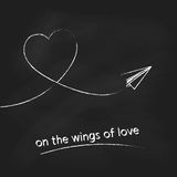 Vector paper plane with heart track on black chalkboard background. Concept for Valentines day design. Stock Image