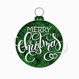 Vector paper sheet with clipped christmas ornament silhouette above fir-tree branches and hand lettering christmas Royalty Free Stock Photo