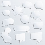 Vector paper speech babbles set in black and white colors on the grey background with dots. Royalty Free Stock Photography