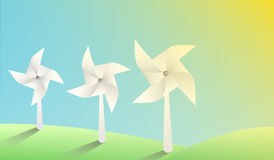 Vector paper windmills on sunny landscape Royalty Free Stock Image
