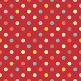 Vector pattern with colorful polka dots in green, yellow, brown and pink on red background Royalty Free Stock Images