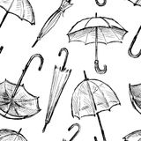 Seamless background of the umbrellas sketches. Vector pattern of the different drawn umbrellas vector illustration