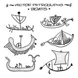 Vector petroglyphs. Boats Stock Photos