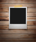 Vector photo frame stick on vintage wooden texture Stock Photo