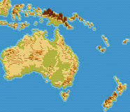 Vector physical map of Australia and Oceania stylized using embossed hexagons. Colored according to relief Stock Photography