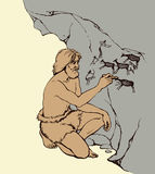 Vector picture. Primitive man draws on stone wall of cave Stock Photos