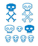 Vector pixel icons , collection of 8bit graphic elements. Simplistic digital signs, human skulls with crossed bones Stock Images