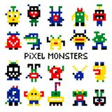 Colored pixelated retro space monsters Stock Photos