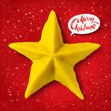 Vector plasticine figure of Christmas star. Vector hand made plasticine figure of Christmas star with shadow isolated on red festive grunge bacground with Royalty Free Stock Photo