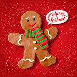 Vector plasticine illustration of gingerbread man. Vector hand made plasticine illustration of gingerbread man cookie with shadow  on red festive grunge Stock Images