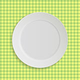 Vector plate on tablecloth Royalty Free Stock Image
