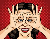 Vector pop art comic style illustration of a young woman face. A girl in search of something. The girl crossed her fingers and. Looks like through binoculars vector illustration