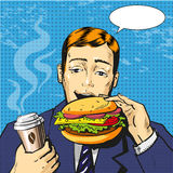 Vector pop art illustration of man eating burger Stock Images