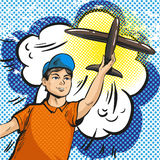 Vector pop art illustration of young boy launching rc plane Stock Photography