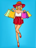 Vector pop art illustration of a young happy girl holding shopping bags. Stock Photo