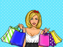 Vector pop art illustration of a young happy girl holding shopping bags. Royalty Free Stock Photos